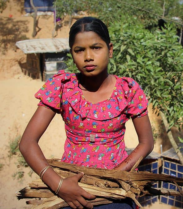 Girl carrying wood