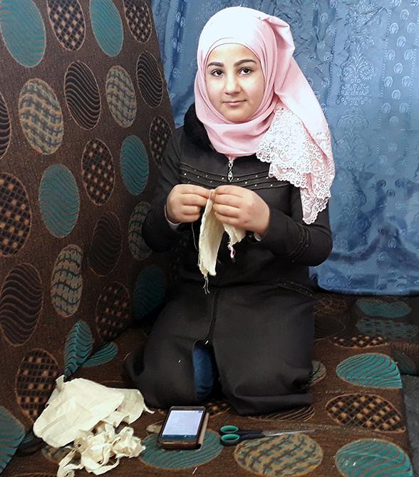 Girl Providing Humanitarian Work In Jordan