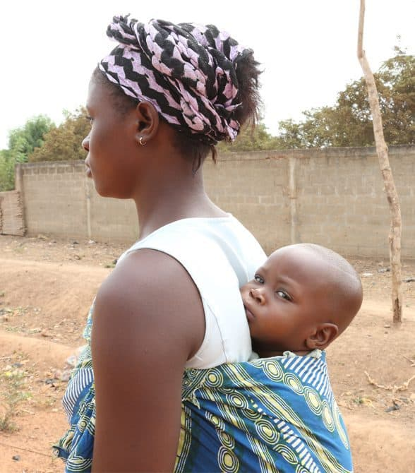 Mother and baby walking in Benin