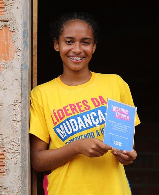 Sponsored Girl in Brazil Holding An Award