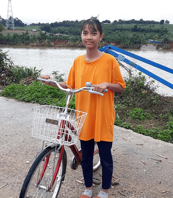 Sponsored Girl In Vietnam Li Na Riding Bike To School