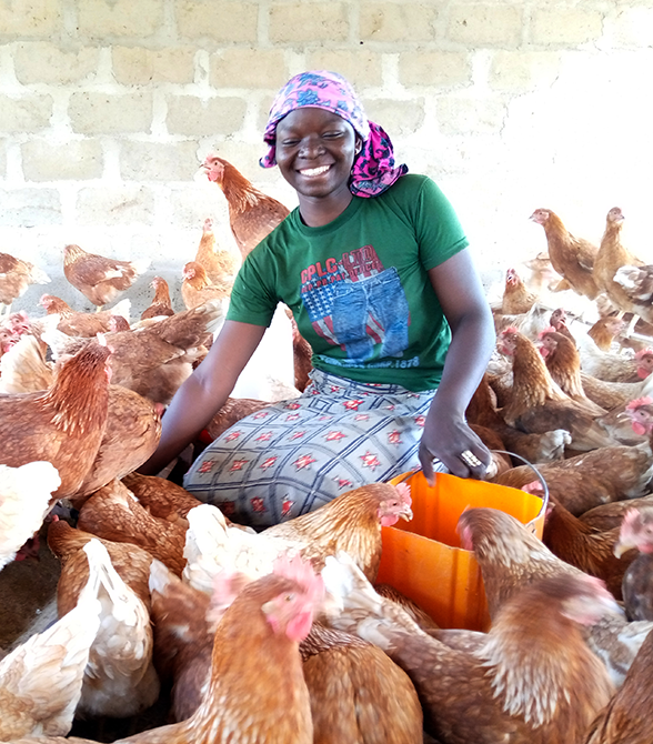 Former Sponsored Child With Chickens
