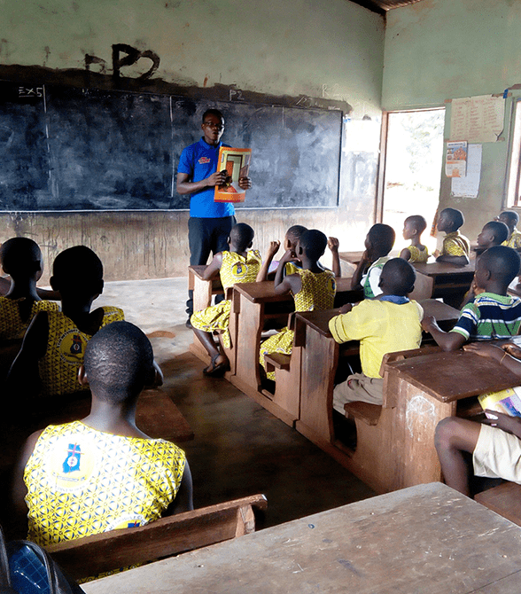 Sponsored Child Presenting To Class In Ghana