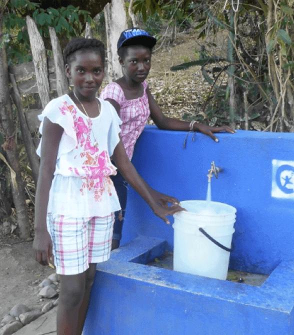 Sponsored Girls In Haiti School Collecting Water