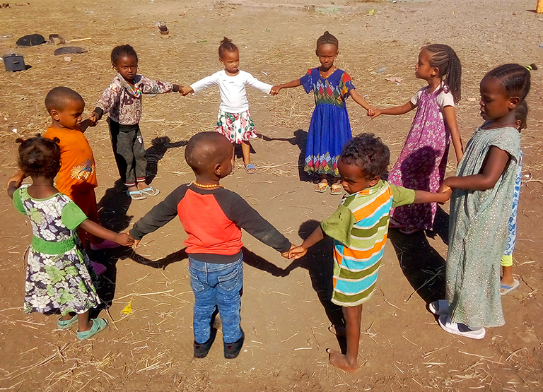 Children Holding Hands Playing
