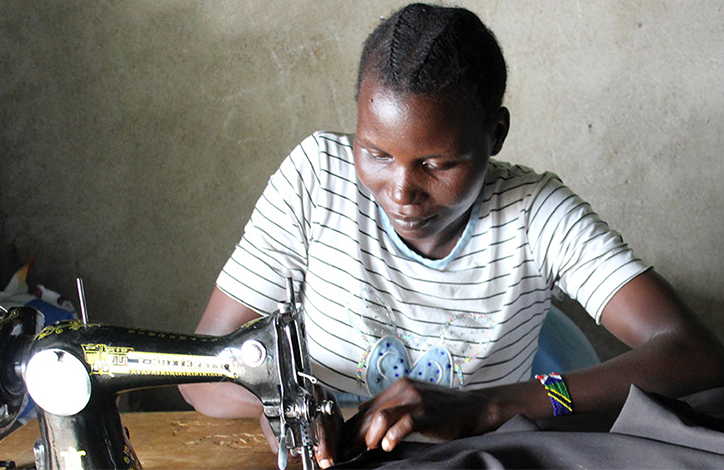 Woman Sewing For Work